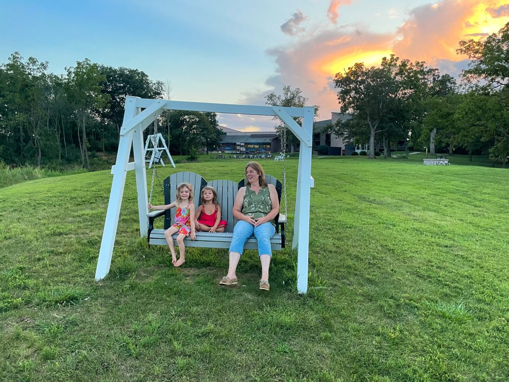 family time on a swing by Deer Creek lake